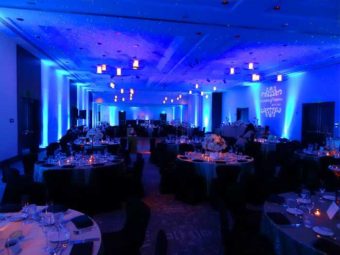 Blue Uplighting for a Wedding Reception | Rent online for $19/each + free shipping both ways nationwide at www.RentMyWedding.com/Rent-Uplighting