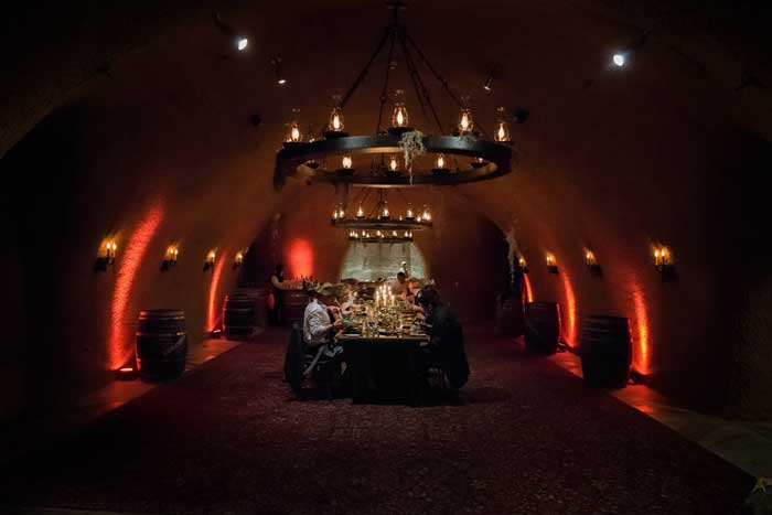 Red uplighting in wine cellar