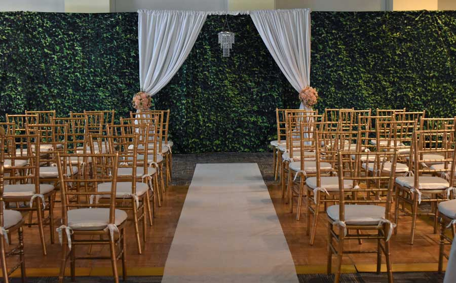 Indoor Ceremony Arch with Greenery Backdrop